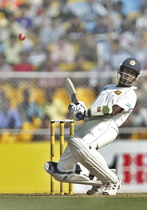 Sri Lanka's Prasanna Jayawardene bends backwards to avoid a delivery during the fourth day of the first Test match against India at the Motera stadium in Ahmedabad on Thursday. (AP Photo)