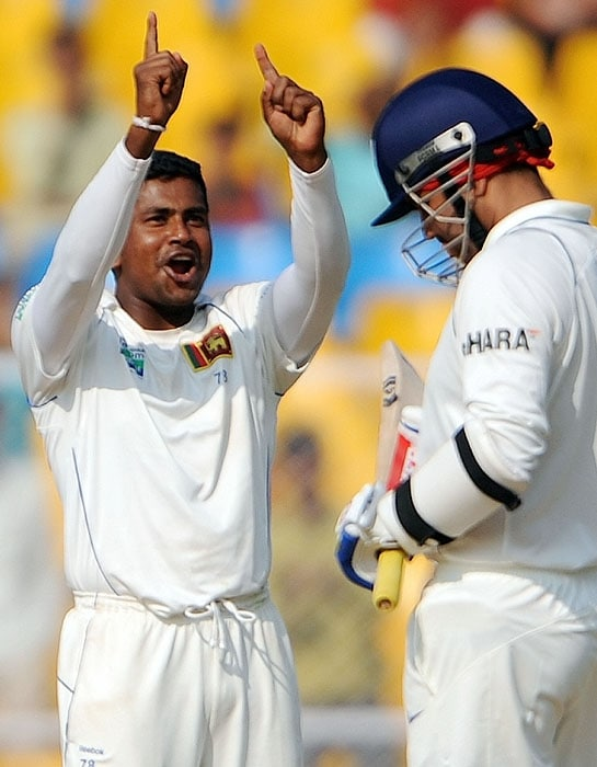 Sri Lanka's Rangana Herath celebrates the wicket of India's Virender Sehwag on the fourth day of the first Test at the Motera stadium in Ahmedabad on Thursday. (AFP Photo)
