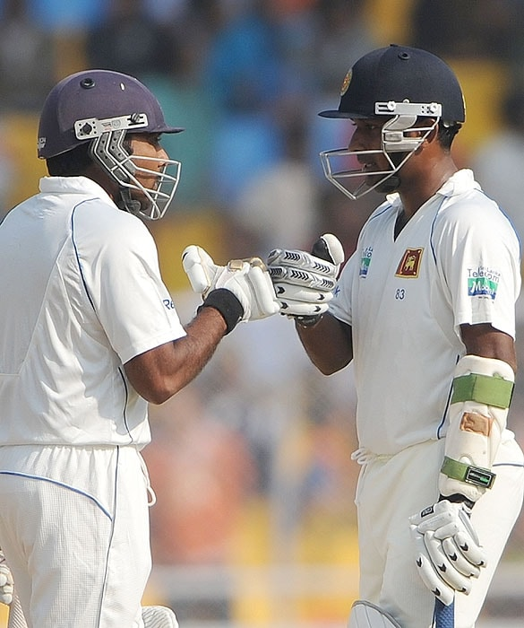 Sri Lanka's Mahela Jayawardene and Prasanna Jayawardene greet each other on the fourth day of the first Test match against India at the Motera stadium in Ahmedabad on Thursday. (AFP Photo)