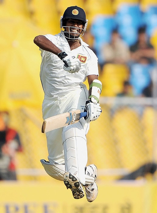 Sri Lanka's Prasanna Jayawardene leaps in air to celebrate his century on the fourth day of the first Test match against India at the Motera stadium in Ahmedabad on Thursday. (AFP Photo)