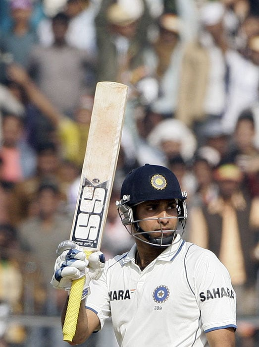 India's V.V.S. Laxman acknowledges the crowd after scoring a half century during the second day of the second Test match at the Green Park Stadium in Kanpur on Wednesday. (AFP Photo)