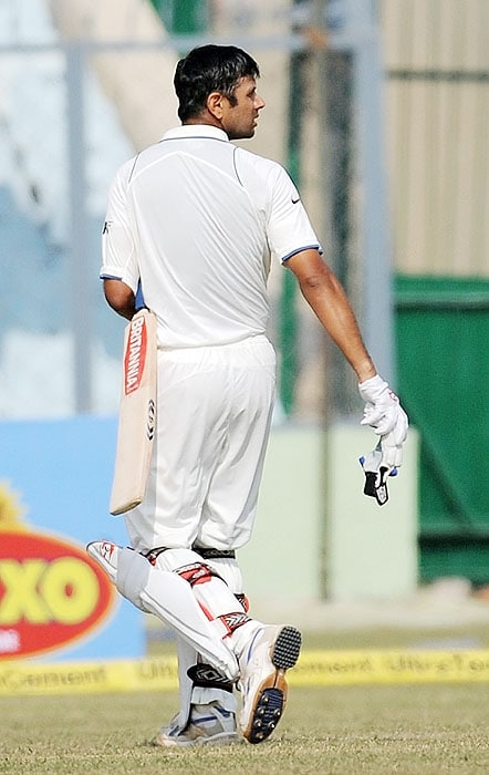 India's Rahul Dravid walks back to the pavilion after his dismissal on the second day of the second Test against Sri Lanka at the Green Park Stadium in Kanpur on Wednesday. (AFP Photo)
