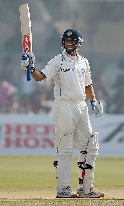 India's Rahul Dravid celebrates scoring his century on the second day of the second Test match against Sri Lanka at the Green Park Stadium in Kanpur on Wednesday. (AFP Photo)
