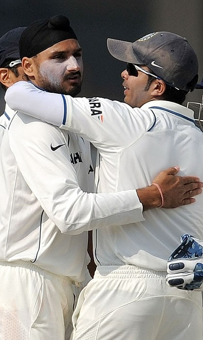India's Harbhajan Singh is congratulated by teammate S Sreesanth after taking the wicket of Sri Lankan Prasanna Jayawardene during the fourth day of the second Test match at the Green Park Stadium in Kanpur on Friday. (AFP Photo)