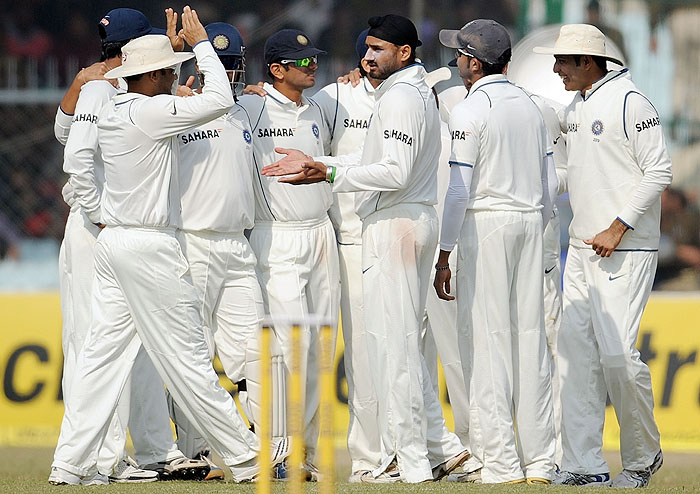 India's Harbhajan Singh celebrates with teammates after taking the wicket of Sri Lanka's Rangana Herath during the fourth day of the second Test match at the Green Park Stadium in Kanpur on Friday. (AFP Photo)