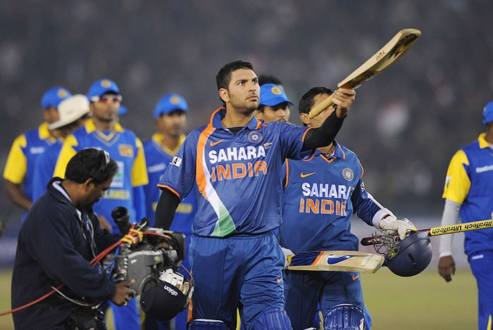 India's Yuvraj Singh raises his bat to mark India's victory of the second Twenty20 International match against Sri Lanka in Mohali on Saturday, December 12, 2009. Sri Lanka won the first Twenty20 match in Nagpur on December 9 by 29 runs. India level two-match series 1-1. (AFP Photo)