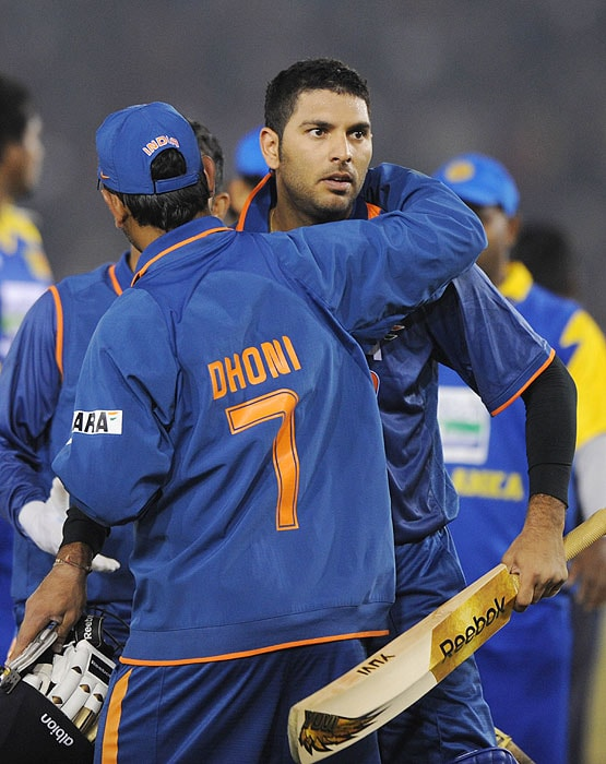 Yuvraj Singh is hugged by Indian captain Mahindra Singh Dhoni at their victory of the second Twenty20 International match against Sri Lanka in Mohali on Saturday. (AFP Photo)