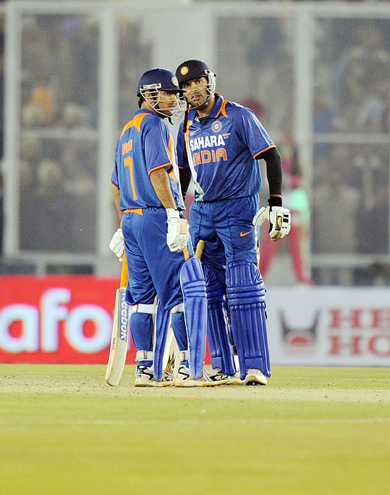 India's Yuvraj Singh and captain MS Dhoni talk during the second Twenty20 International match against Sri Lanka in Mohali on Saturday. (AFP Photo)