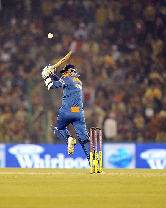 India's Virender Sehwag hits a shot during the second Twenty20 International match against Sri Lanka in Mohali on Saturday. (AFP Photo)