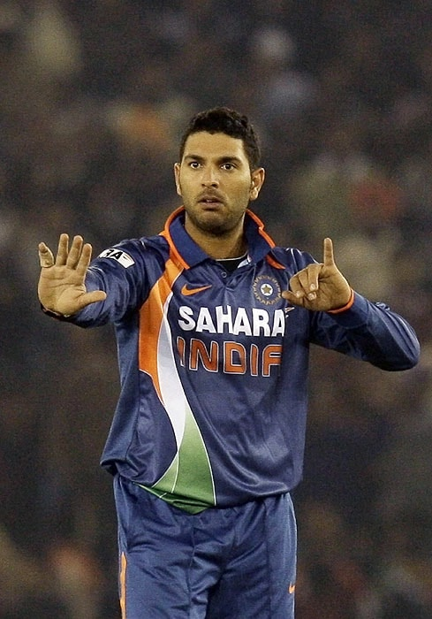 India's Yuvraj Singh reacts as he points out his injured finger to a fielder during the second Twenty20 match against Sri Lanka in Mohali on Saturday. (AP Photo)