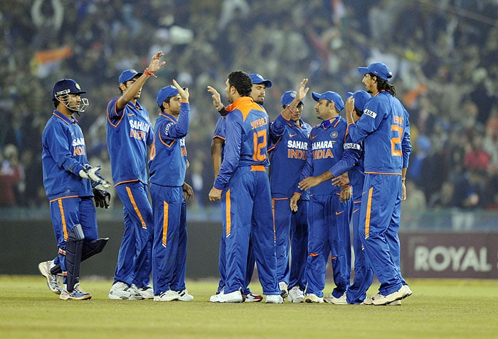 Indian cricketers celebrate the wicket of Sri Lanka's Tillakaratne Dilshan during the second Twenty20 International match against Sri Lanka in Mohali on Saturday. (AFP Photo)