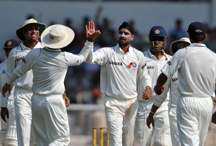 VVS Laxman congratulates teammate Harbhajan Singh for the wicket of Tharanga Paranavitana on the first day of the third Test between India and Sri Lanka in Mumbai. (AFP Photo)