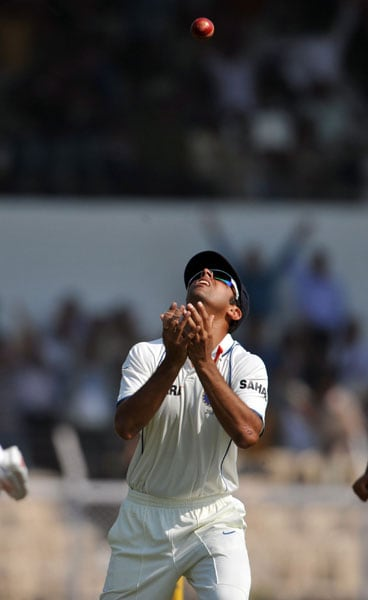 Rahul Dravid celebrates after taking the catch for the wicket of Tharanga Paranavitana on the first day of the third Test between India and Sri Lanka in Mumbai. (AFP Photo)