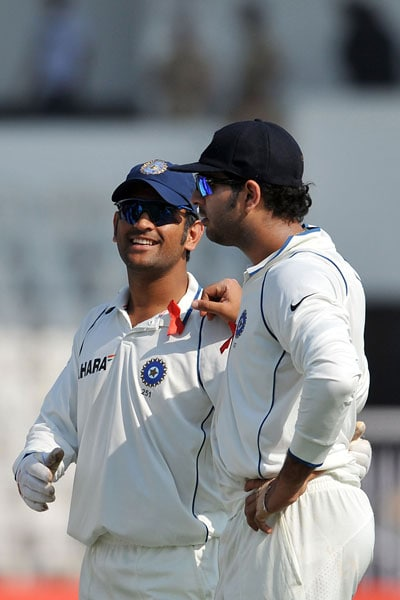 Mahendra Singh Dhoni and teammate Yuvraj Singh share a light moment during the drinks break on the first day of the third Test between India and Sri Lanka in Mumbai. (AFP Photo)