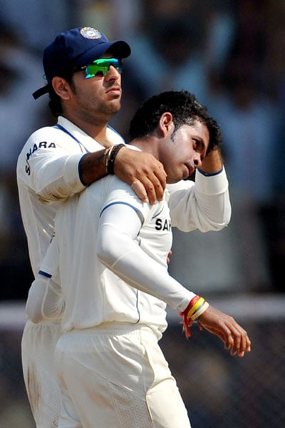 Yuvraj Singh congratulates teammate S Sreesanth for the wicket of Mahela Jayawardene on the first day of the third Test between India and Sri Lanka in Mumbai. (AFP Photo)