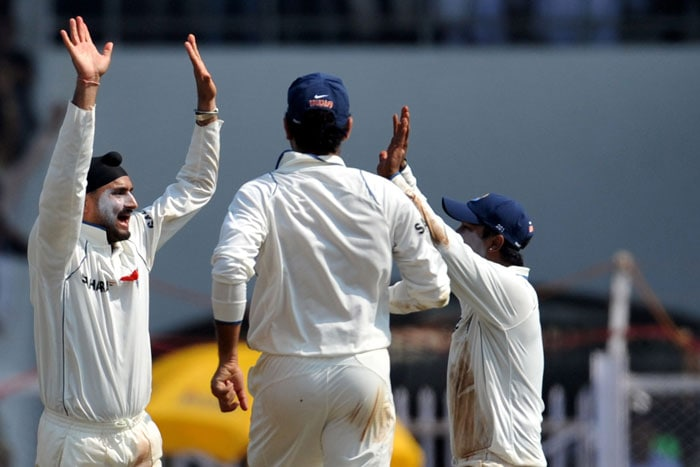 Harbhajan Singh celebrates the wicket of Thilan Samaraweera on the first day of the third Test between India and Sri Lanka in Mumbai. (AFP Photo)