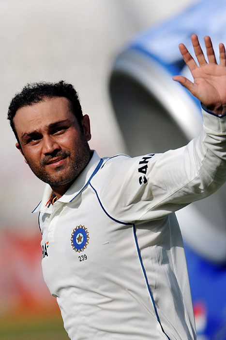 India's Virender Sehwag waves on his way to the pavilion after scoring double century on the second day of the third Test against Sri Lanka in Mumbai on Thursday, December 3, 2009. India trails by 51 runs with 9 wickets remaining in the 1st innings, Sri Lanka scored 393 runs. India leads the 3-match series 1-0. (AFP Photo)