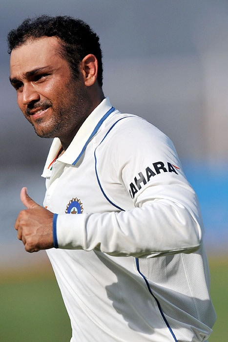 India's Virender Sehwag gives a thumbs up on his way to the pavilion after scoring double century on the second day of the third Test against Sri Lanka in Mumbai on Thursday. (AFP Photo)