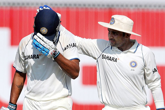 India's Murli Vijay is congratulated for his effort by his teammate Virender Sehwag after his dismissal during second day of the third Test against Sri Lanka in Mumbai on Thursday. (AFP Photo)