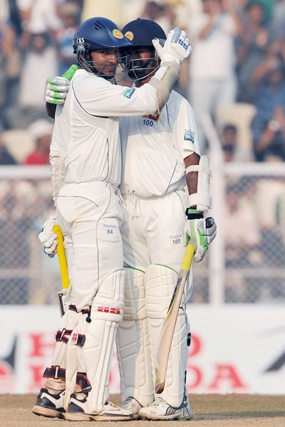 Sri Lankan captain Kumar Sangakkara is congratulated by teammate Nuwan Kulasekara as he completes his century on the fourth day of the third Test match against India and Sri Lanka in Mumbai. (AFP Photo)