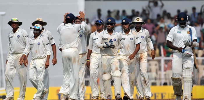 Indian cricketers celebrate the wicket of Angelo Mathews on the fourth day of the third Test between India and Sri Lanka in Mumbai. (AFP Photo)