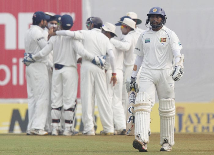 Harbhajan Singh celebrates the wicket of Tillakaratne Dilshan with his teammates on the fourth day of the third and final Test at the Brabourne stadium in Mumbai on Saturday. (PTI Photo)