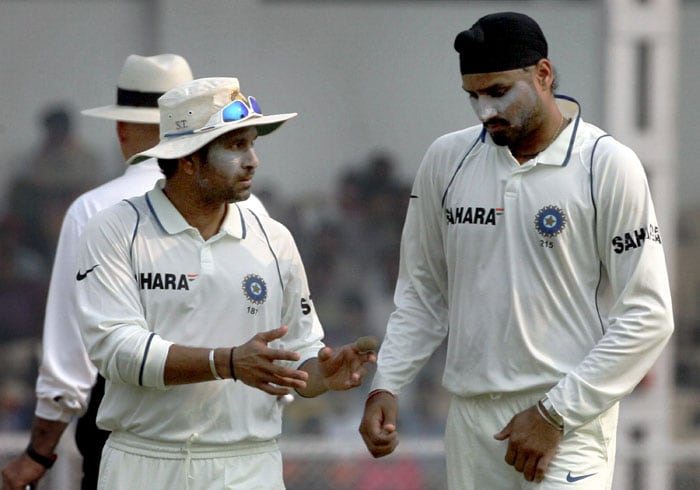 Sachin Tendulkar with Harbhajan Singh as he prepares to bowl on the fourth day of the final Test in Mumbai. (PTI Photo)