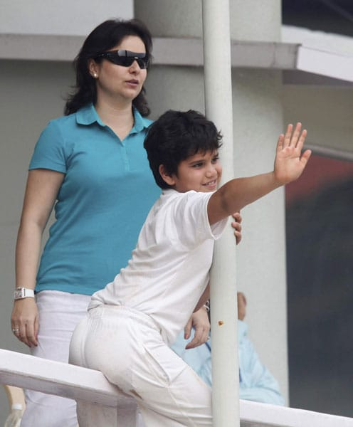Sachin Tendulkar's wife Anjali and son Arjun watch play on the fourth day of the third and final Test in Mumbai. (PTI Photo)