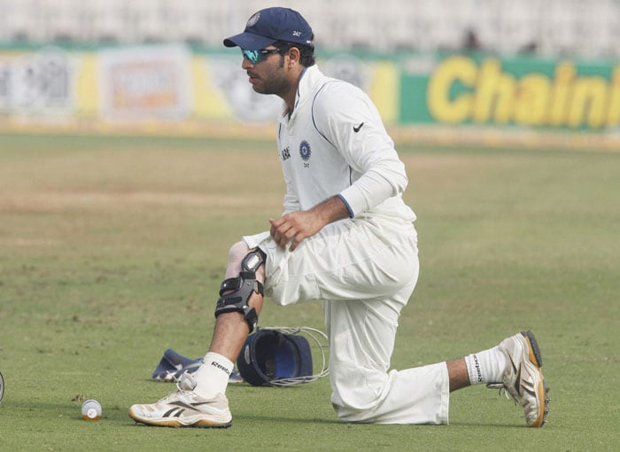 Yuvraj Singh adjusts his knee supporter on the fourth day of the third and final Test at the Brabourne stadium in Mumbai. (PTI Photo)