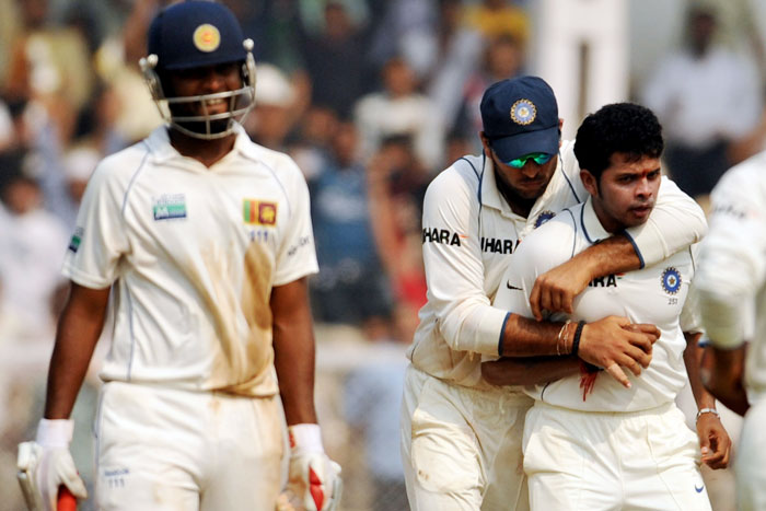 Yuvraj Singh and S Sreesanth celebrate the wicket of Tharanga Paranavitana on the fourth day of the third Test between India and Sri Lanka in Mumbai. (AFP Photo)