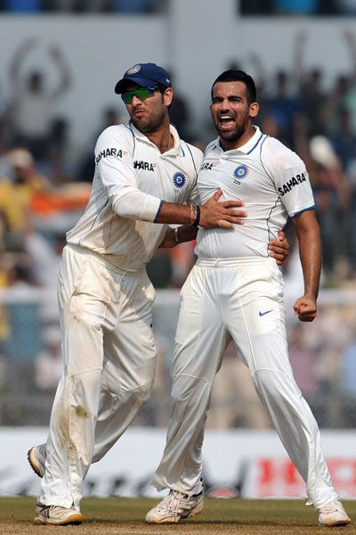 Yuvraj Singh congratulates teammate Zaheer Khan after he dismissed Mahela Jayawardene during the fourth day of the third Test match between India and Sri Lanka at The Brabourne Stadium in Mumbai. (AFP Photo)