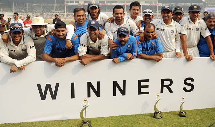 Indian cricketers pose for a team photo after winning on the final day of the third Test against Sri Lanka in Mumbai on Sunday. (AFP Photo)