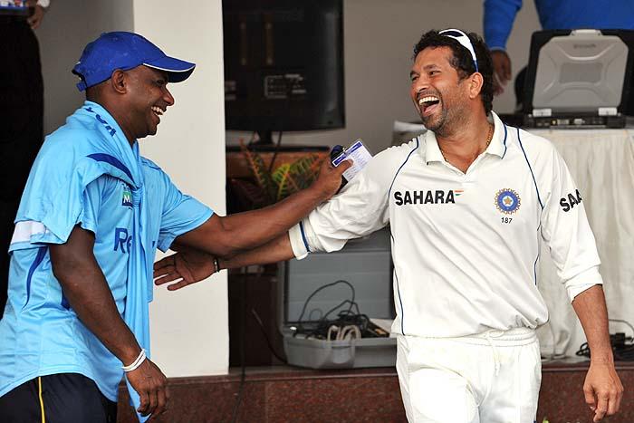 Sri Lanka's Sanath Jayasurya and India's Sachin Tendulkar share a light moment after the final day of the third Test in Mumbai on Sunday. (AFP Photo)