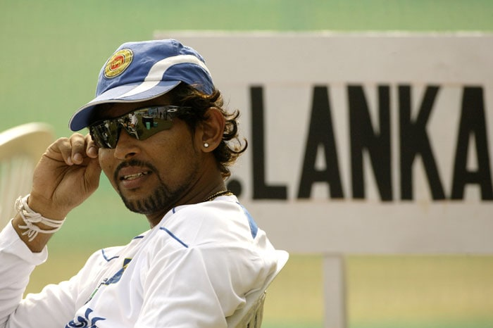 Tillakaratne Dilshan relaxes after a practice session in Kanpur.