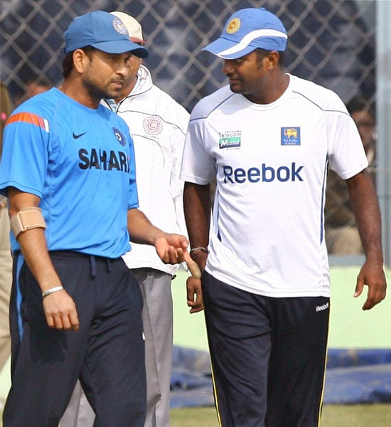 Sachin Tendulkar with Muttiah Muralitharan during a practice session on the eve of second Test between India and Sri Lanka in Kanpur.