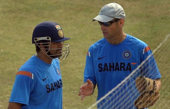 Sachin Tendulkar talks with coach Gary Kirsten during a training session at the Green Park Stadium in Kanpur.