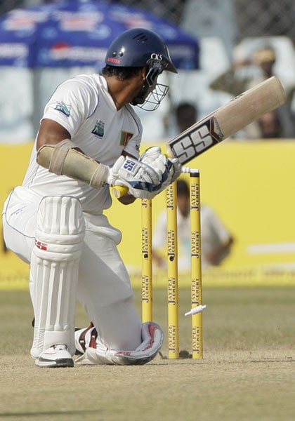 Kumar Sangakkara looks back to see the bail being dislodged from the wicket resulting in his dismissal during the third day of the second Test between India and Sri Lanka in Kanpur.