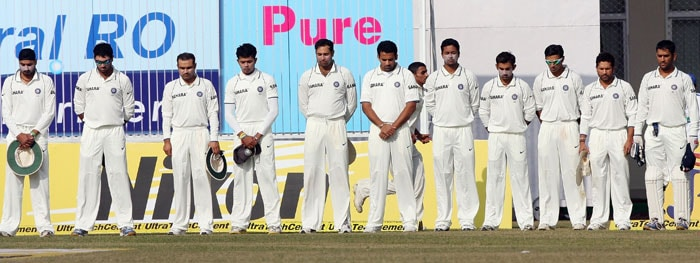 Members of the Indian team observe a minute's silence before the start of play against Sri Lanka on the third day of the second Test match at the Green Park Stadium in Kanpur. India marked the first anniversary of the 2008 militant attacks in Mumbai with a series of ceremonies to honour the 166 victims killed in the deadly rampage by 10 Islamist gunmen.