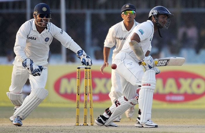 Indian captain Mahendra Singh Dhoni and teammate Rahul Dravid celebrate the dismissal of Kumar Sangakkara during the third day of the second Test match at the Green Park Stadium in Kanpur.