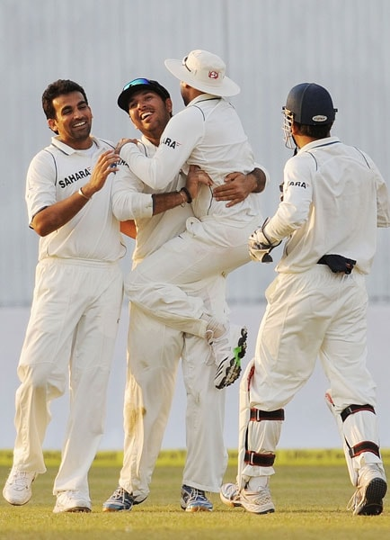 Yuvraj Singh is congratulated by teammates after running-out Mahela Jayawardene during the third day of the second Test match at the Green Park Stadium in Kanpur. (AFP Photo)