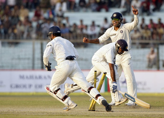 Mahendra Singh Dhoni and VVS Laxman appeal for the run out of Mahela Jayawardene after Sri Lanka followed on during the third day of the second Test between India and Sri Lanka in Kanpur.