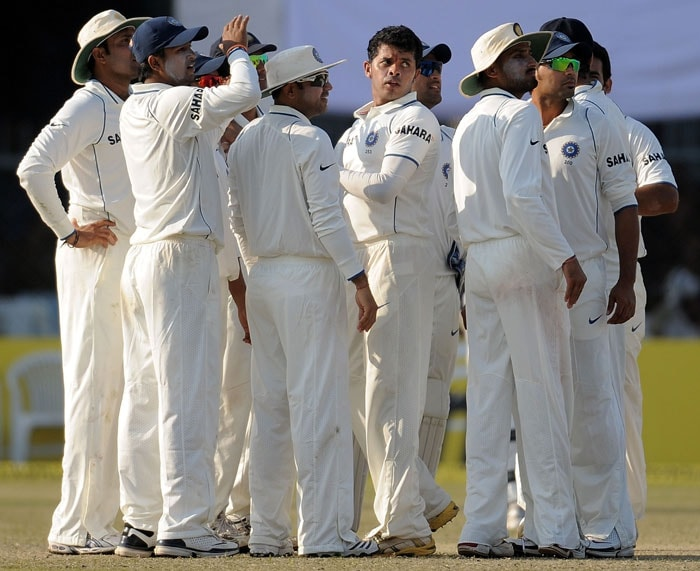 Shanthakumaran Sreesanth celebrates with teammates after taking the wicket of Tillakaratne Dilshan during the third day of the second Test match at the Green Park Stadium in Kanpur.