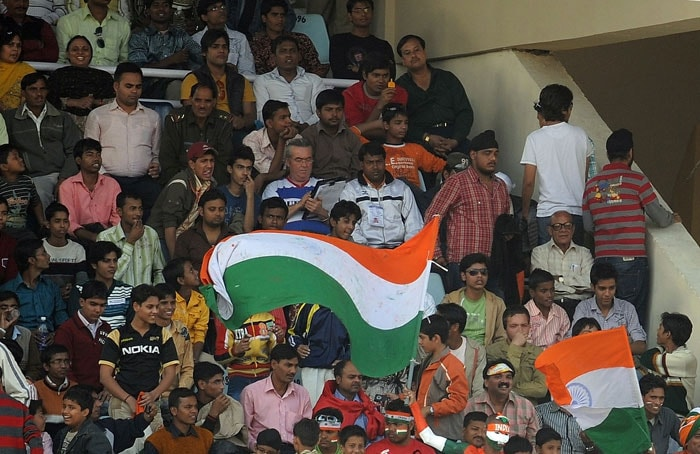 Indian fans cheer on the third day of the second Test match at the Green Park Stadium in Kanpur. Sri Lanka were all-out for 229 runs in their first innings giving India a lead of 413 runs.