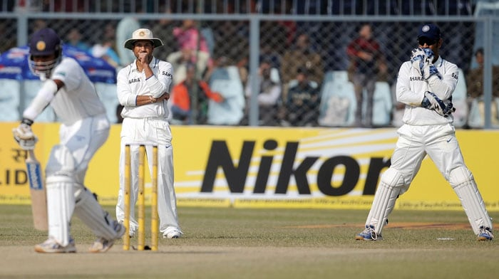 Sachin Tendulkar and Mahendra Singh Dhoni react after dropping a catch off Mahela Jayawardena on the third day of the second Test match at the Green Park Stadium in Kanpur.