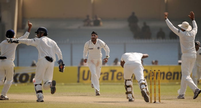 Harbhajan Singh reacts after taking the wicket of Angelo Mathews on the third day of the second Test match at the Green Park Stadium in Kanpur.
