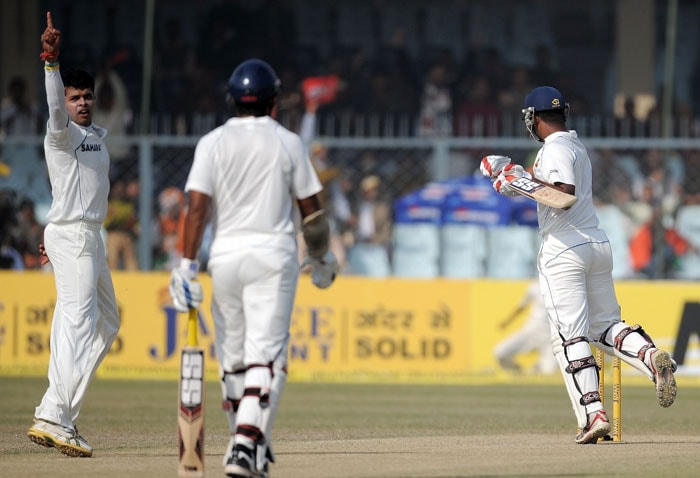 Shanthakumaran Sreesanth reacts after taking the wicket of Tharanga Paranavitana on the third day of the second Test match at the Green Park Stadium in Kanpur.