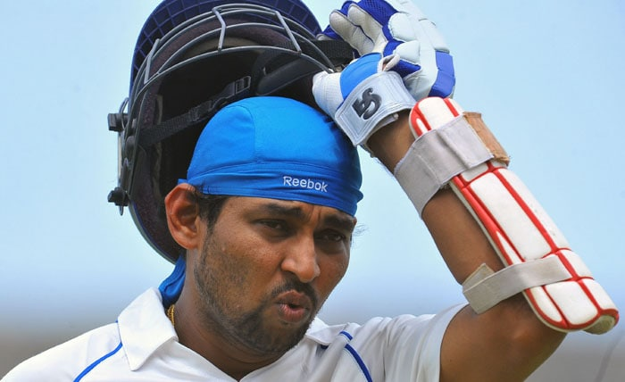 Tillakaratne Dilshan walks back to the pavilion after his dismissal during the first day of the first Test match between Sri Lanka and India at The Galle International Cricket Stadium in Galle. (AFP Photo)