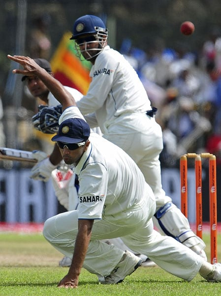 Rahul Dravid dives as he attempts to field a ball hit by Kumar Sangakkara during the first day of the first Test match between Sri Lanka and India at The Galle International Cricket Stadium in Galle. (AFP Photo)