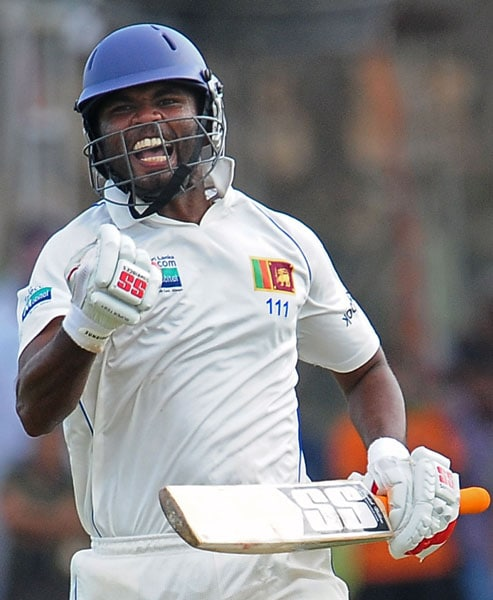 Tharanga Paranavitana reacts as he celebrates scoring a century (100 runs) during the first day of the first Test match between Sri Lanka and India at The Galle International Cricket Stadium in Galle. (AFP Photo)