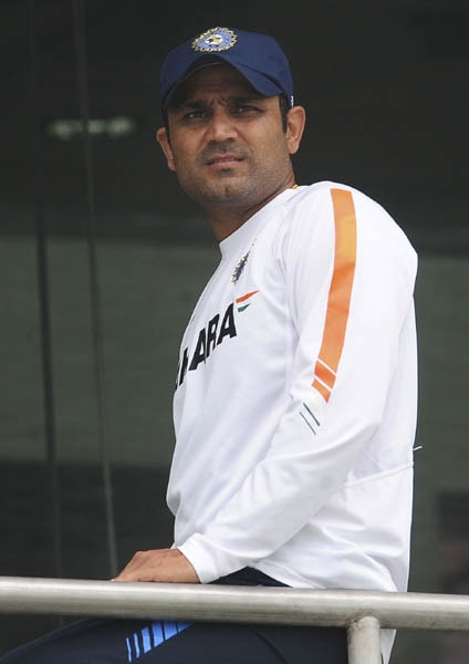 Indian cricketer Virender Sehwag looks on from the dressing room after the second day of the first Test match between Sri Lanka and India was called off due to rain at the Galle International Cricket Stadium in Galle. The second day's play in the first Test was abandoned without a ball being bowled due to bad weather. (AFP Photo)